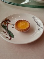 Egg custard tarts (蛋撻) originated in local Hong Kong cafes in the 1940's. A flaky, outer pastry crust is filled with sweet, delicate egg custard and baked.
