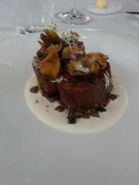 Suffolk lamb loin, eggplant skin and olive puree, sheep's milk creme fraiche, fresh and preserved flowers.