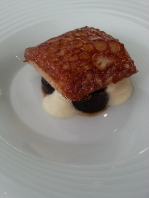 Berkshire pig jowl, maltose crackling, prunes, cauliflower creame, with prune kernel oil.